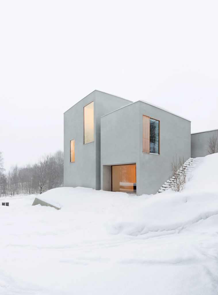 Small White Building In Snow