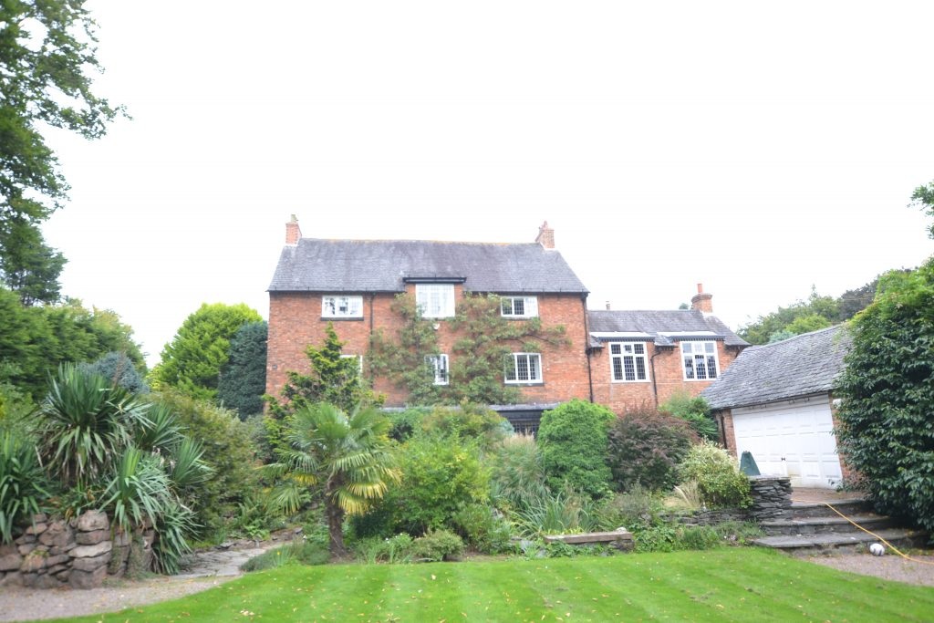 listed building with large garden