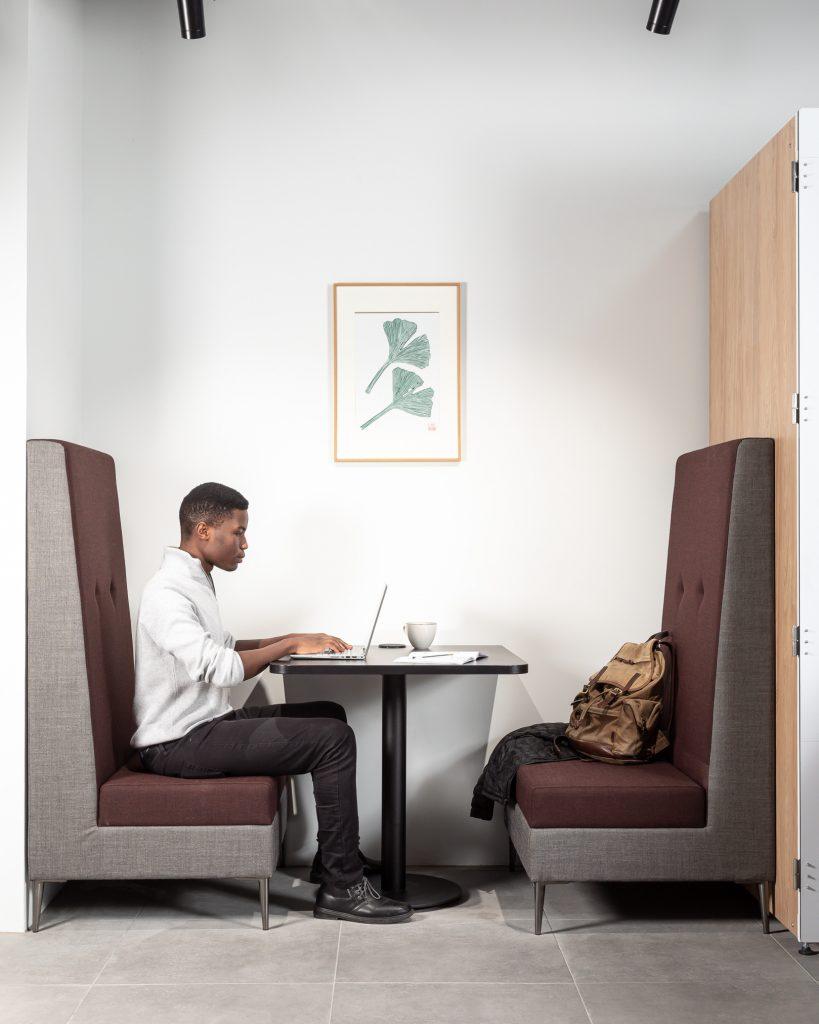 Man sitting at individual table